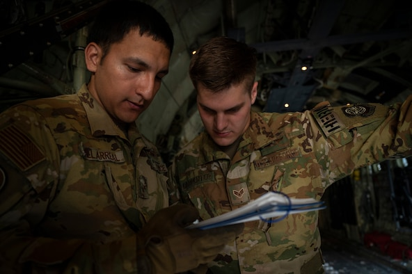 U.S. Air Force Airman 1st Class Jorge Villarreal, left, and U.S. Air Force Senior Airman Jacob Carpenter, loadmasters assigned to the 41st Airlift Squadron, review cargo checklists on a U.S. Air Force C-130J Super Hercules assigned to the 19th Airlift Wing at Alpena Combat Readiness Training Center, Michigan, May 21, 2021. Mobility Guardian accelerates change for the Air Force and Air Mobility Command by developing the force and advancing warfighting capabilities to enhance our ability to project the Joint Force and ensure strategic deterrence. (U.S. Air Force photo by Staff Sgt. Joseph Pick)