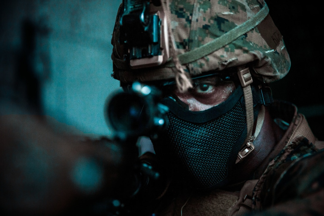 U.S. Marine Corps Lance Cpl. Thomas Porter III, a rifleman with 3rd Battalion, 2nd Marine Regiment, 2nd Marine Division, provides security during a night raid as a part of Exercise Raven in Nashville, Tenn., May 24, 2021. Exercise Raven is an integrated training event with Marines from 3/2 and Marine Corps Forces Special Operations Command which simulates real-life tactical scenarios to enhance overall unit interoperability, effectiveness and lethality against an adversarial force.