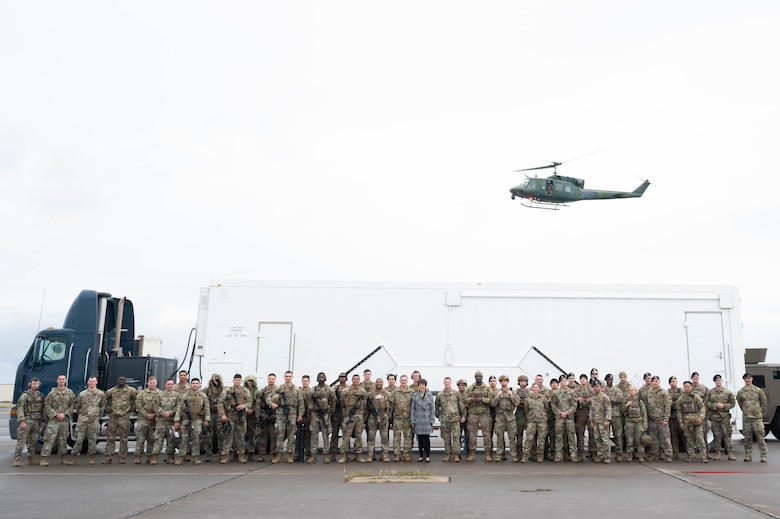 Gen. Tim Ray, Air Force Global Strike Command commander, his wife, Mrs. Rhonda Ray, and Chief Master Sgt. Charles Hoffman, AFGSC command chief, pose for a photo with members of the 341st Missile Security Operations Squadron May 25, 2021, at Malmstrom Air Force Base, Mont.