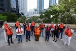 Members of the Coast Guard District Seven wear their life jackets in support of Wear Your Life Jacket at Work Day in Miami, Florida, May 21, 2021. This event marks the start of National Safe Boating Week which helps raise boating safety awareness. (U.S. Coast Guard photo by Petty Officer 3rd Class Jose Hernandez)