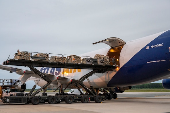 Airmen from the 436th Aerial Port Squadron load cargo onto an aircraft in support of a security assistance mission between the U.S. and Ukraine at Dover Air Force Base, Delaware, May 24, 2021. The U.S. and Ukraine first initiated a partnership in 1993. Missions such as this demonstrate the U.S.'s commitment to Ukraine's independence, sovereignty and territorial integrity. (U.S. Air Force photo by Airman 1st Class Cydney Lee)