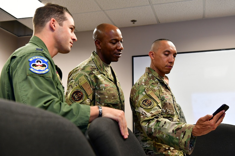 Chief Master Sergeant of the Air Force Kaleth O. Wright, views a loadmaster training video with Chief Master Sgt. Manny Piñeiro, Air Force special duty manager for first sergeants, and Capt. Joseph Hunt, 314th Airlift Wing chief of group tactics, at Little Rock Air Force Base, Arkansas, Oct. 3, 2019. Wright visited multiple units across the installation including the 19th AW, 314th AW, and 189th AW to learn about Herk Nation's singular focus on Combat Airlift. (U.S. Air Force photo by Airman 1st Class Aaron Irvin)