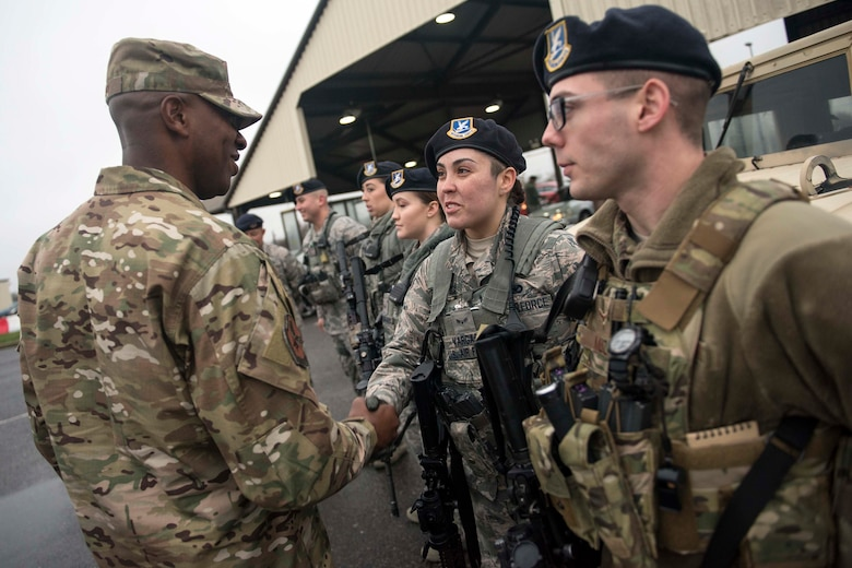 U.S. Air Force Chief Master Sgt. of the Air Force Kaleth O. Wright shakes hands with a 100th Security Forces Squadron Airman during a visit at RAF Mildenhall, England, Dec. 26, 2018. Both Wright and Air Force Chief of Staff Gen. David L. Goldfein visited Team Mildenhall prior to heading back to the U.S. after a visit to U.S. Central Command during the holidays. (U.S. Air Force photo by Staff Sgt. Christine Groening)