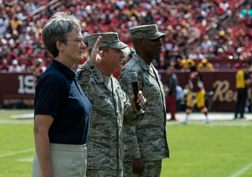 Secretary of the Air Force Heather Wilson, Chief of Staff of the Air Force Gen. David L. Goldfein and Chief Master Sgt. of the Air Force Kaleth O. Wright swear in delayed entry members during the Washington Redskins versus Philadelphia Eagles game at the FedExField in Hyattsville, Md., Sept. 10, 2017. The game was dedicated to the men and women of the U.S. Air Force in celebration of the service's 70th birthday.(U.S. Air Force photo by Senior Airman Rusty Frank/Released)