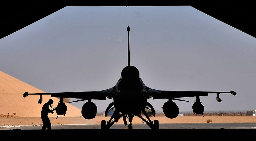 A weapons loader from the 125th Expeditionary Fighter Squadron performs a post-flight check on an F-16 Fighting Falcon after its arrival in Iraq. The squadron deployed in support of Operation New Dawn and will provide close air support for more than 40,000 troops leaving Iraq by the end of the year.  (U.S. Air Force photo by Master Sgt. Cecilio Ricardo)