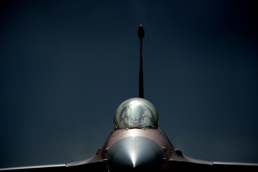 An F-16 Fighting Falcon goes through final inspection at the end of the runway before flying an exercise Red Flag 15-2 training mission.(U.S. Air Force photo/Master Sgt. Jeffrey Allen)