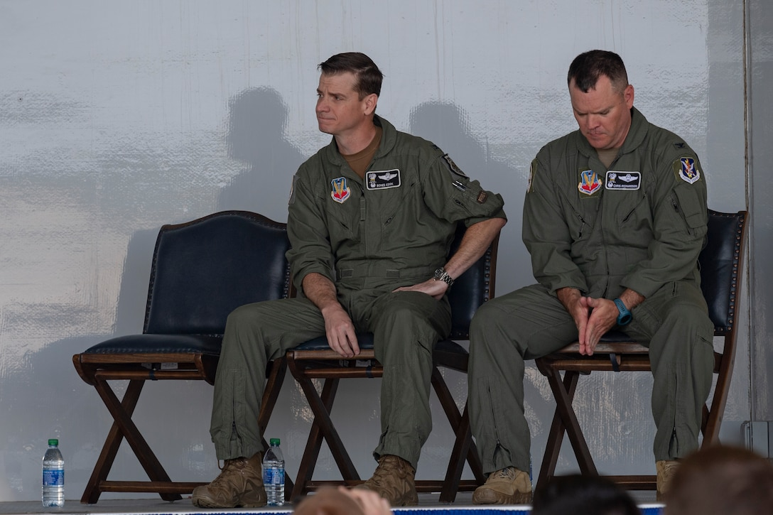 Photo of Airmen listening to remarks during a ceremony