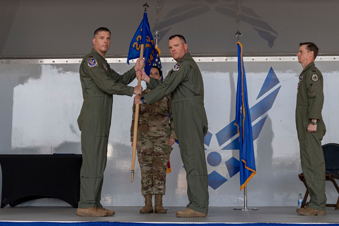 Photo of an Airman receiving a guidon during a ceremony