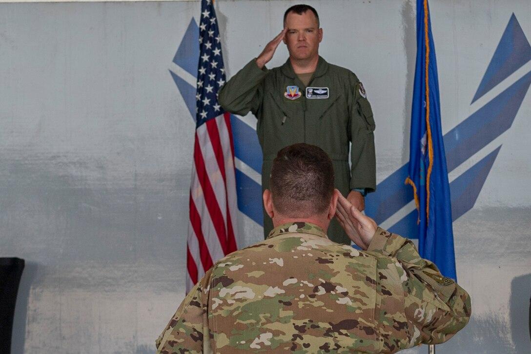 Photo of an Airman receiving a salute