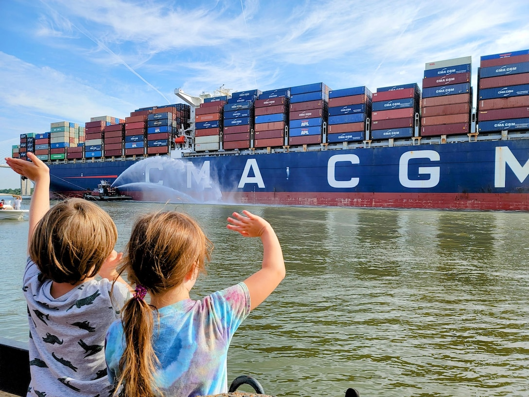 Oscar, 5, and Audrey, 6, welcome CMA CGM GROUP (Official) Marco Polo to Savannah this morning (May 26).  At 1,300 feet long and carrying 16,000+ containers, Marco Polo is the largest vessel to call on Georgia Ports Authority and the East Coast.  Photo by Molly Hayden.