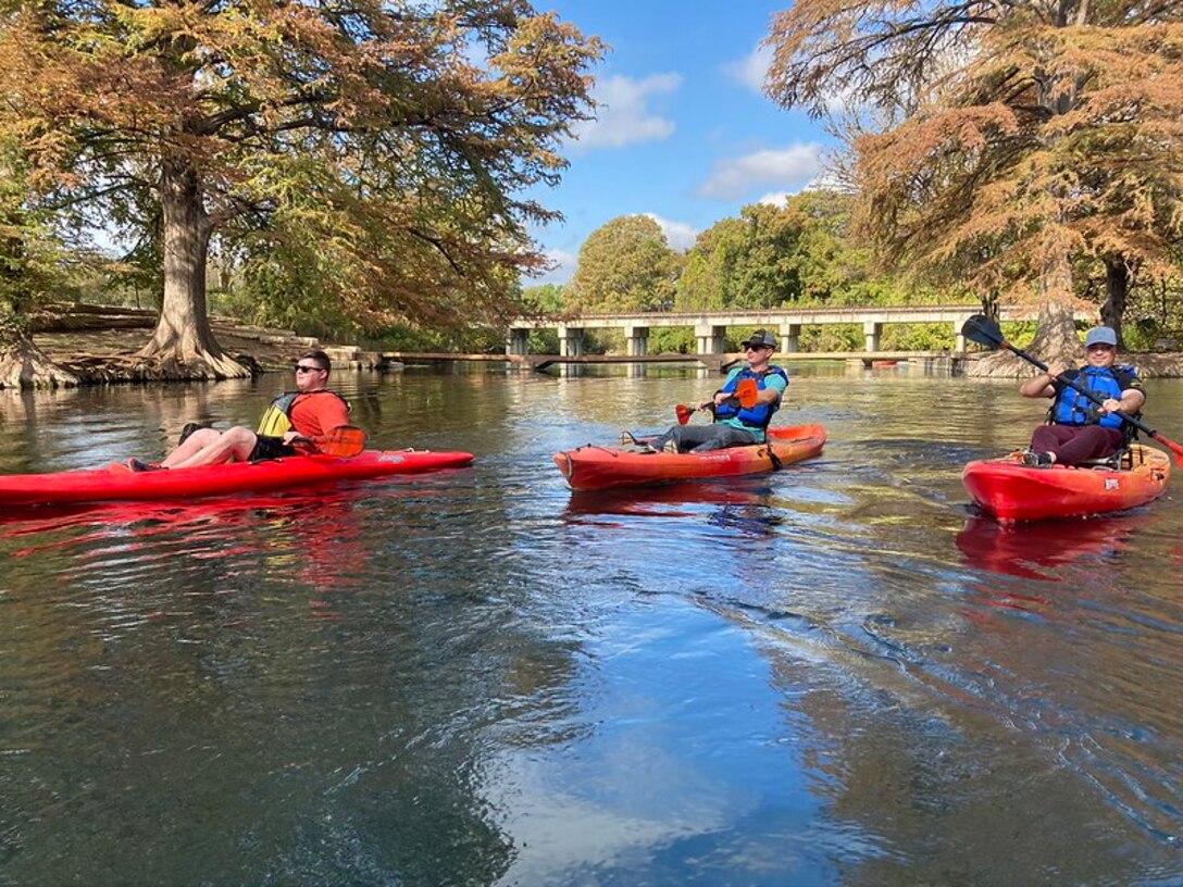 Service members kayaking on San Marcos River.