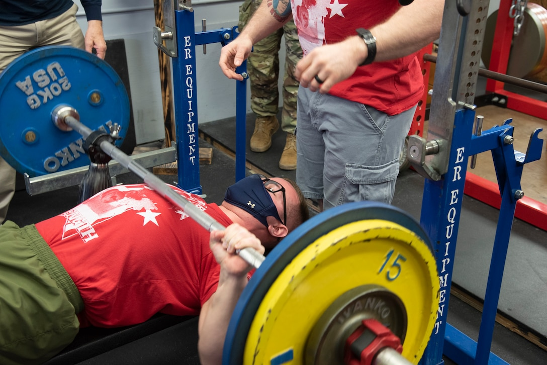 U.S. Marine bench presses during warmup.
