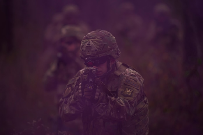 Members of the 823rd Base Defense Squadron move through smoke as concealment from simulated enemy forces, Moody Air Force Base, Jan. 12, 2018. The 823rd is one of three operational security forces squadrons under the 820th Base Defense Group whose mission is to provide high-risk force protection and integrated base defense for expeditionary forces. (U.S. Air Force photo by Bennie J. Davis III)