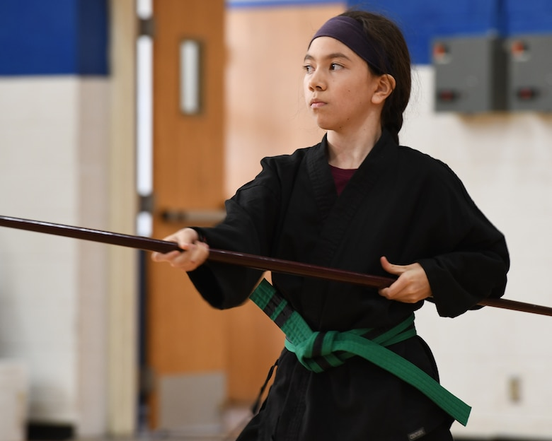 Girl demonstrates Bo staff use.