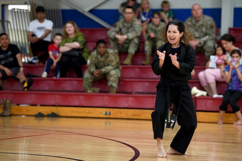 Woman demonstrates karate.