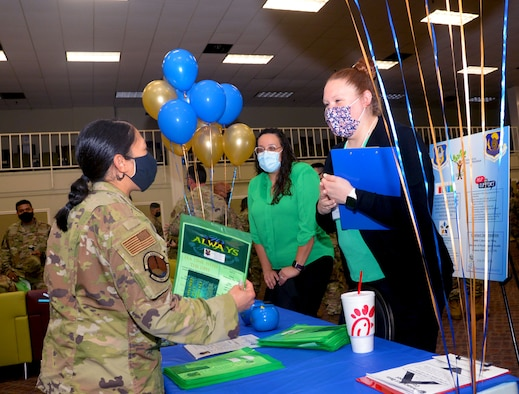 Maj. Joya Gamara, 854th Combat Operations Squadron chief of combat plans division, speaks with Christina Avalos, 960th Cyberspace Wing psychological health volunteer, and Christyn Mundy, 960th CW psychological health intern, during the Mental Health and Resiliency Fair, May 1, 2021, at Joint Base San Antonio-Lackland, Texas. (U.S. Air Force photo by Tech. Sgt. Samantha Mathison)