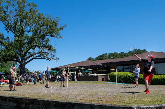 Members of Team Seymour gather to play badminton at the Outdoor Recreation Adventure Park, on Seymour Johnson Air Force Base, North Carolina, May 14, 2021.