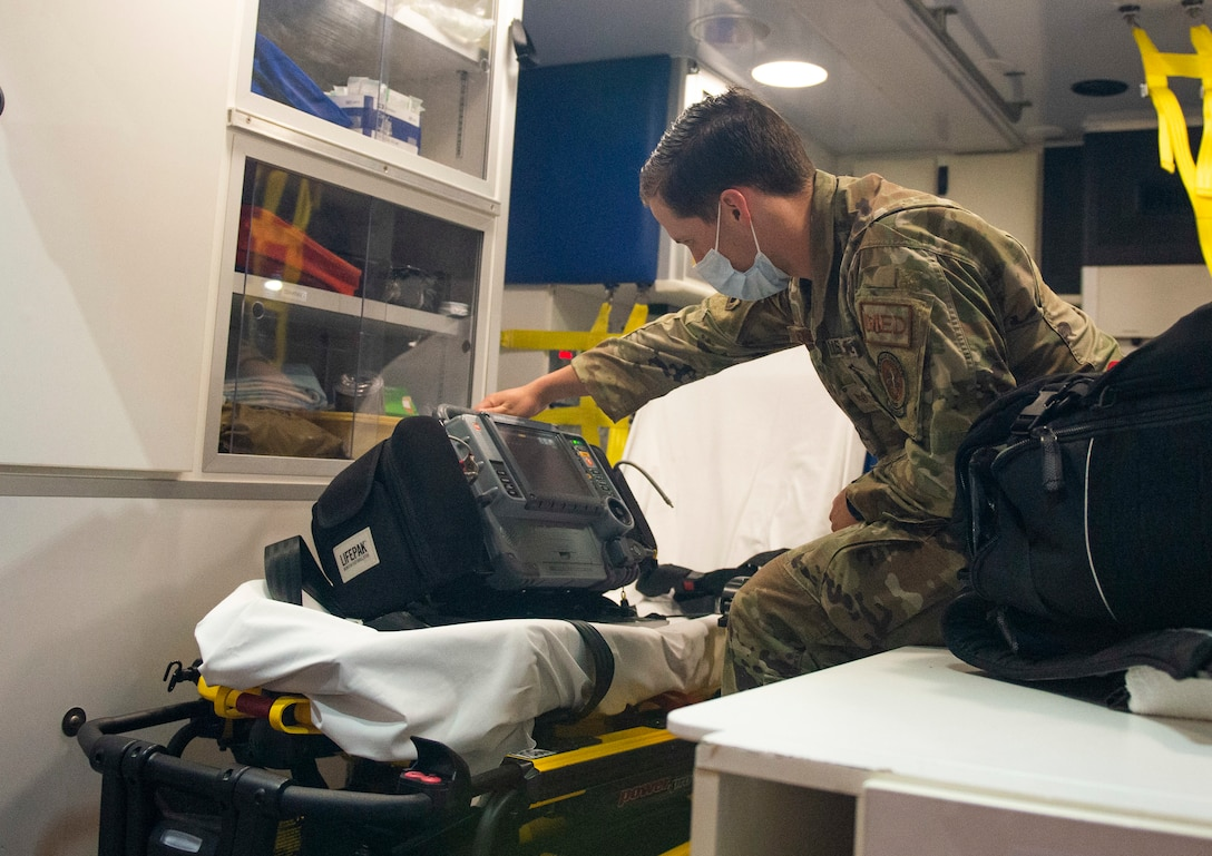 U.S. Air Force Staff Sgt. David Henderson, a paramedic with the 88th Medical Group, performs an inspection of equipment inside the ambulance outside the Wright-Patterson Air Force Base, Ohio Medical Center, April, 28, 2021. The medical center is open 24 hours a day with medical personnel standing by to treat anyone that comes through their door. (U.S. Air Force photo by Wesley Farnsworth)
