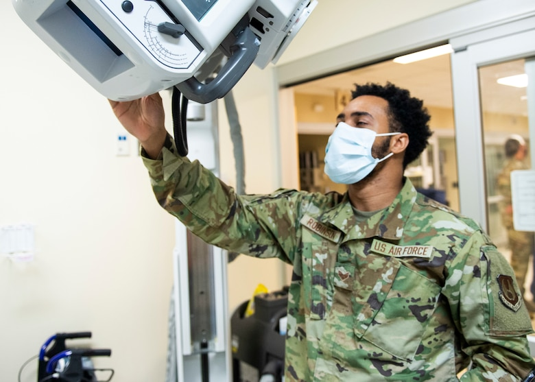 U.S. Air Force Senior Airman Jikhail Robinson, a radiologic technologist with the 88th Medical Group, takes a portable chest x-ray of a patient inside the emergency room of the Wright-Patterson Air Force Base, Ohio Medical Center, April, 28, 2021. The medical center is open 24 hours a day with medical personnel standing by to treat anyone that comes through their door. (U.S. Air Force photo by Wesley Farnsworth)