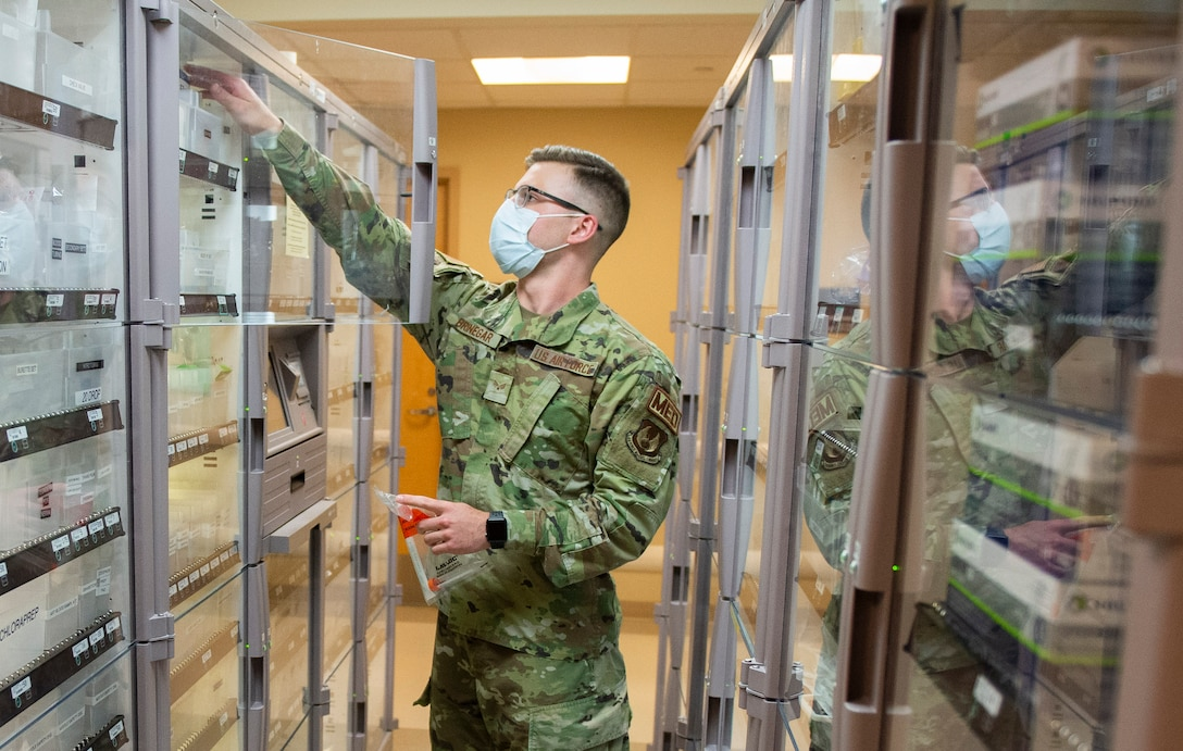 U.S. Air Force Senior Airman Joshua Bringer, a medical technician with the 88th Medical Group, retrieves supplies in the emergency room of the Wright-Patterson Air Force Base, Ohio Medical Center, April, 28, 2021. The medical center is open 24 hours a day with medical personnel standing by to treat anyone that comes through their door. (U.S. Air Force photo by Wesley Farnsworth)