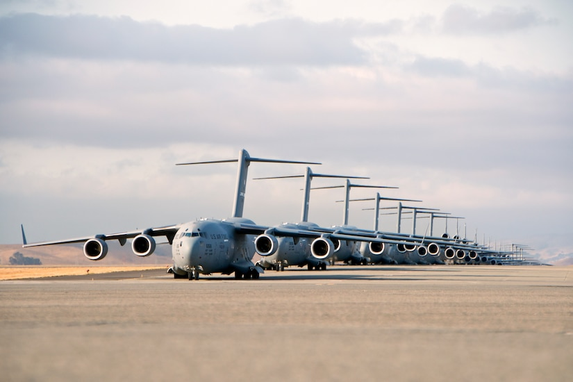 Seven U.S. Air Force C-17 Globemaster III aircraft, 11 KC-10 Extender aircraft and four C-5 Galaxy aircraft assigned to the 60th Air Mobility Wing line up at Travis Air Force Base, Calif., Sept. 11, 2013, for the Freedom Launch honoring the victims of the 9/11 terrorist attacks. The first plane departed at 8:46 a.m., the same time terrorists crashed American Airlines Flight 11 into the North Tower of the World Trade Center, with the remaining 21 aircraft launching consecutively during a 36-minute time frame. Terrorists hijacked four passenger aircraft Sept. 11, 2001. Two of the aircraft were deliberately crashed into the World Trade Center in New York; one was crashed into the Pentagon; the fourth crashed near Shanksville, Pa. Nearly 3,000 people died in the attacks. (DoD photo by David Cushman, U.S. Air Force/Released)