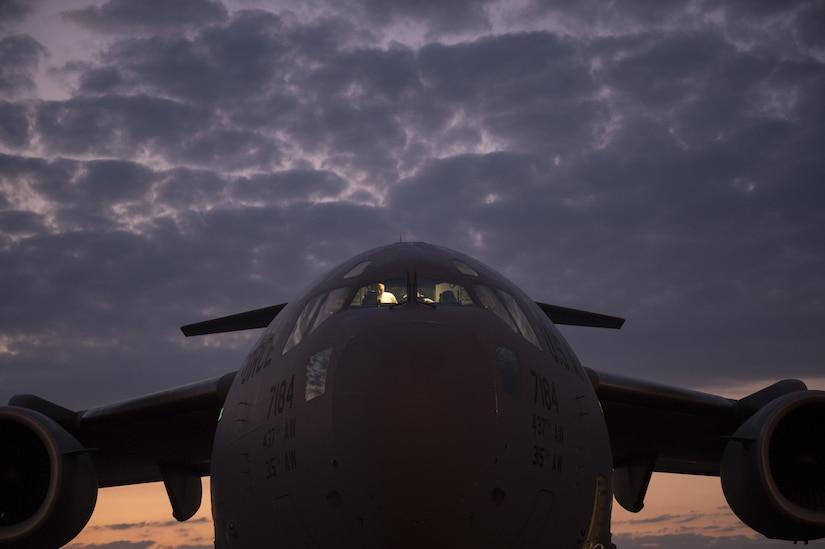 Airmen from the 315th Airlift Wing work to prepare a C-17 Globemaster III for an airdrop mission with Soldiers from the 82nd Airborne Division during exercise Crescent Reach 16 on May 26, 2016, at Joint Base Charleston, S.C. Crescent Reach is an annual exercise designed to test and evaluate Joint Base Charleston�s ability to mobilize and launch a large-scale aircraft formation in addition to training, processing and deploying Airmen and cargo in response to a simulated crisis abroad. (U.S. Air Force photo/Tech. Sgt. Jason Robertson)