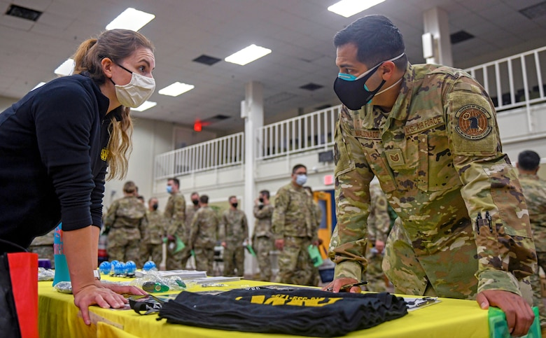 Kristen Myers, Ft. Sam Houston Army Wellness Center health education advocate, talks about physical health and fitness with Tech. Sgt. Damon Maldonado, 426th Network Warfare Squadron cyber warfare operator, during the 960th Cyberspace Wing Mental Health and Resiliency Fair, May 1, 2021, at Joint Base San Antonio-Lackland, Texas. (U.S. Air Force photo by Airman First Class Tyler McQuiston)