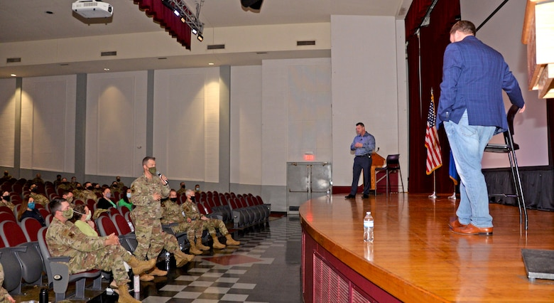 Col. Mark Estlund, 960th Cyberspace Operations Group commander, asks a question to Ernie Stevens and Joe Smarro, San Antonio Police Department Mental Health Unit officers, during the 960th Cyberspace Wing Mental Health and Resiliency Fair, May 1, 2021, at Joint Base San Antonio-Lackland, Texas. (U.S. Air Force photo by Tech. Sgt. Samantha Mathison)