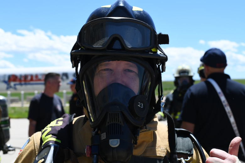 ¬¬¬¬¬¬¬¬¬¬¬¬¬¬¬¬¬¬Lt. Col. Kevin P. Campbell, 460th Mission Support Group commander, prepares for a fire exercise, May 25, 2021, on Buckley Air Force Base, Colo. The Buckley Fire Department showed Buckley Garrison leadership what their duties may entail with a simulated two-story fire exercise. (U.S. Space Force photo by Senior Airman Michael D. Mathews)