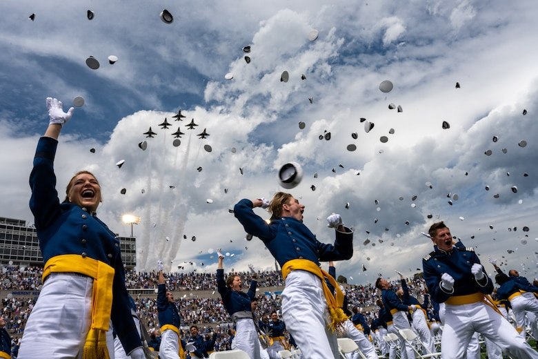 """The U.S. Air Force Air Demonstration Squadron """"Thunderbirds"""" perform a fly-over at the Air Force Academy graduation at Falcon Stadium in Colorado Springs, Colo., May 26, 2021. In all, 1,019 cadets graduated in front of a select crowd due to safety and health precautions set in place for the ceremony as the Academy continues to operate during the pandemic. (U.S. Air Force photo by Staff. Sgt Laurel M. Richards)"""