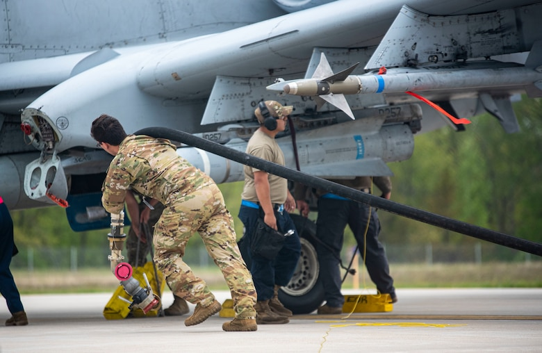 An A-10 Thunderbolt II is refueled May 25, 2021, during exercise Mobility Guardian at Alpena Combat Readiness Training Center, Michigan. Mobility Guardian is a training exercise designed to prepare Airmen to face real-world security challenges and sustain strategic deterrence anywhere in the world. (U.S. Air Force photo by Airman 1st Class Matthew Porter)