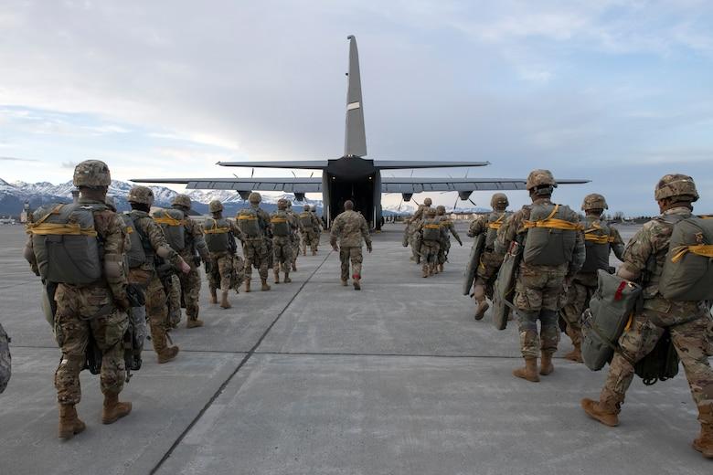Soldiers board a C-130J
