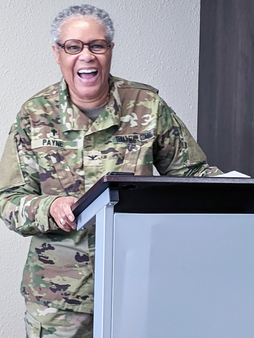 Woman in military uniform behind podium.