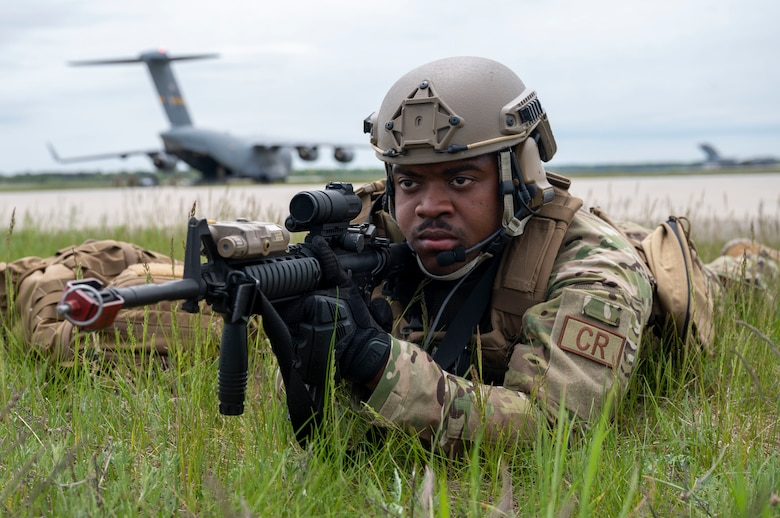 U.S. Air Force Senior Airman Nyle Winston, 321st Contingency Response Squadron security team member, secures a refueling area at Alpena Combat Readiness Training Center, Michigan, May 24, 2021, in support of Exercise Mobility Guardian 2021. Mobility Guardian tests Mobility Airmen through a challenging, realistic and detailed scenario based on relevant real-world security challenges. (U.S. Air Force photo by Senior Airman Aaron Irvin)