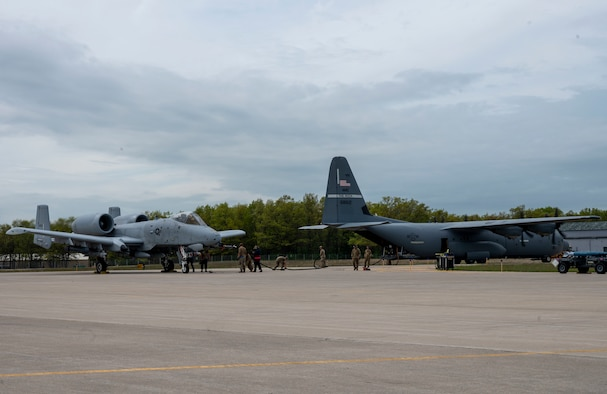 Airmen fuel an A-10 Thunderbolt II using an Aerial Bulk Fuel Delivery System out the back of a C-130J Super Hercules at Alpena Combat Readiness Training Center, Michigan, May 24, 2021, in support of Exercise Mobility Guardian 2021. The ABFDS, a portable 3,000-gallon fuel bladder, can be loaded on a C-130J Super Hercules, C-5 Galaxy, or C-17 Globemaster III and transported anywhere around the world. (U.S. Air Force photo by Senior Airman Aaron Irvin)