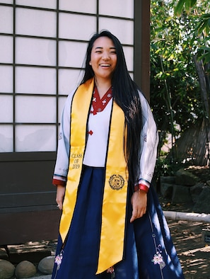 U.S. Air Force 2nd Lt. Michelle Chang, 92nd Air Refueling Wing public affairs command information chief, poses for a graduation photo, at California State University Long Beach, 10 May, 2019. Chang is wearing a hanbok, a traditional Korean dress, worn to represent her culture and heritage. (Courtesy photo)