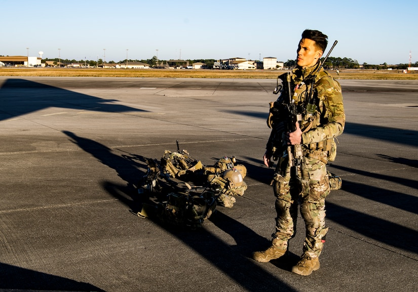 Major Alexander Le, an emergency physician with the U.S. Air Force Special Operations Surgical Team (SOST), prepares for a rapid infiltration mission aboard a  MC-130H Combat Talon II from the 15th Special Operations Squadron, Hurlburt Field, Fl., before flight operations for training as part of Exercise Emerald Warrior 19, Jan. 16, 2019. Emerald Warrior provides annual realistic and relevant pre- deployment training encompassing multiple joint operating areas to prepare Special Operations Forces, Conventional Force enablers, Partner Nations and Interagency elements to integrate with and execute full spectrum Special Operations in a complex and uncertain Irregular Warfare security environment using all aspects of live, virtual, and constructive training assets. (U.S. Air Force Photo by Tech. Sgt. Gregory Brook)