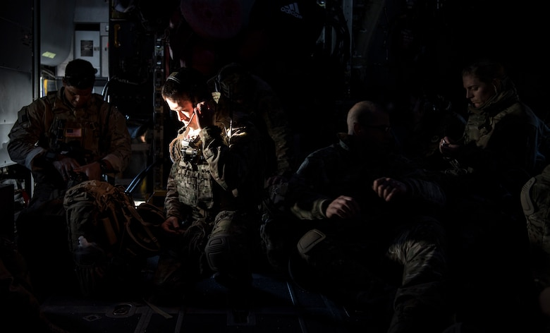 U.S. Air Force Special Operations Surgical Team members check their gear on a MC-130H Combat Talon II from the 15th Special Operations Squadron, Hurlburt Field, Fl., during rapid infiltration flight operations for training as part of Exercise Emerald Warrior 19, Jan. 16, 2019. Emerald Warrior provides annual realistic and relevant pre- deployment training encompassing multiple joint operating areas to prepare Special Operations Forces, Conventional Force enablers, Partner Nations and Interagency elements to integrate with and execute full spectrum Special Operations in a complex and uncertain Irregular Warfare security environment using all aspects of live, virtual, and constructive training assets. (U.S. Air Force Photo by Tech. Sgt. Gregory Brook)