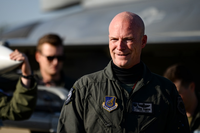 A commander smiles after his final flight.