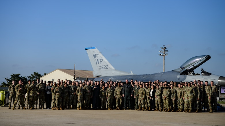 Airmen pose for a photo.