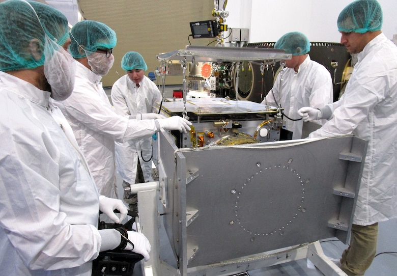 U.S. Air Force Academy cadets clean the components of the FalconSat-6 satellite they and their instructors built at the Academy at Vandenberg Air Force Base, California, in November. The satellite successfully launched into space Dec. 3, 2018 from Vandenberg. (Courtesy photo)