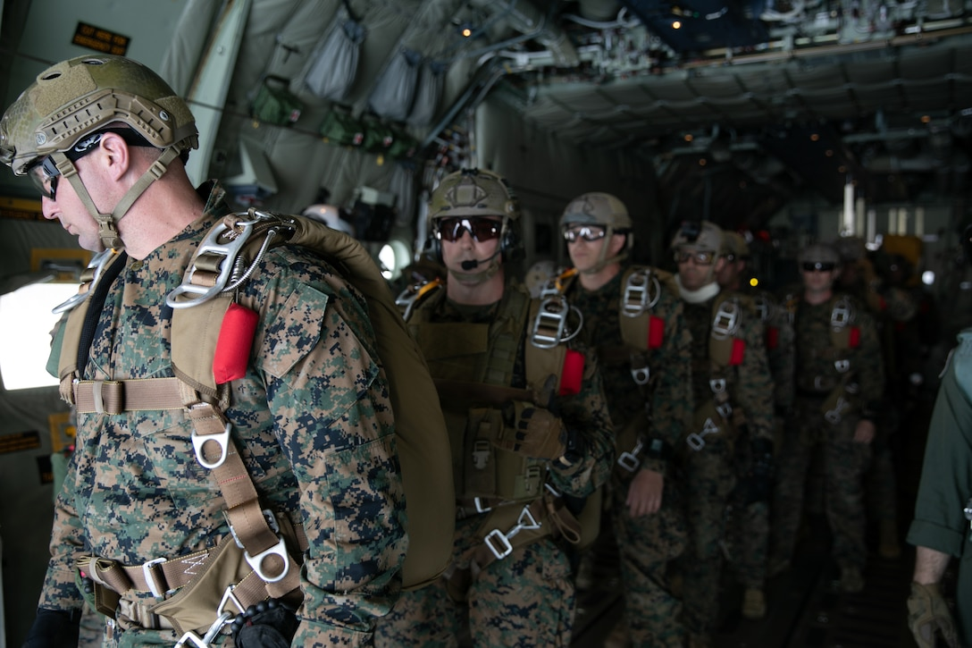 """U.S. Marines with 3d Reconnaissance Battalion, 3d Marine Division, conduct free fall jumps at Ie Shima Island, Okinawa, Japan, Feb. 24, 2021.CLR-3 is conducting Hagåtña Fury 21 in concert with elements of 3d Marine Division (MARDIV), 1st MAW, and Maritime Prepositioning Squadron 3 in order to build and test a """"Fight Now"""" force capable of providing expeditionary sustainment from key maritime terrain in support of III MEF. During the exercise, CLR-3 is operating with 3D MARDIV and 1st MAW to execute seizure and defense of key maritime terrain and expeditionary advanced base sustainment operations around Okinawa, while simultaneously conducting an MPF offload and distributed command and control from Naval Base Guam. 3d MLG, based out of Okinawa, Japan, is a forward deployed combat unit that serves as III Marine Expeditionary Force's comprehensive logistics and combat service support backbone for operations throughout the Indo-Pacific area of responsibility. (U.S. Marine Corps photo by LCpl. Sebastian Aponte)"""