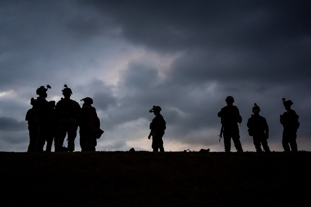 """U.S. Marines with 3d Landing Support Battalion, Combat Logistics Regiment 3, 3d Marine Logistics Group, conduct a night combat marksmanship range during Hagåtña Fury 21, Feb. 23, 2021, on Camp Hansen, Okinawa, Japan. CLR-3 is conducting Hagåtña Fury 21 in concert with elements of 3d Marine Division (MARDIV), 1st Marine Aircraft Wing, and Maritime Prepositioning Squadron 3 in order to build and test a """"Fight Now"""" force capable of providing expeditionary sustainment from key maritime terrain in support of III MEF. During the exercise, CLR-3 is operating with 3D MARDIV and 1st MAW to execute seizure and defense of key maritime terrain and expeditionary advanced base sustainment operations around Okinawa, while simultaneously conducting an MPF offload and distributed command and control from Naval Base Guam. 3d MLG, based out of Okinawa, Japan, is a forward deployed combat unit that serves as III Marine Expeditionary Force's comprehensive logistics and combat service support backbone for operations throughout the Indo-Pacific area of responsibility. (U.S. Marine Corps photo by Cpl. Sarah Marshall)"""