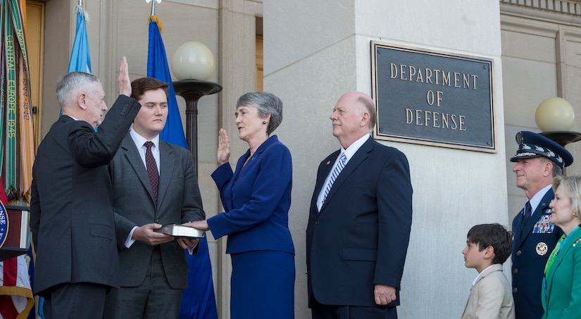 Secretary of Defense Jim Mattis administers the oath of office for Secretary of the Air Force Heather Wilson during her swearing-in ceremony May 16, 2017, at the Pentagon in Washington, D.C.  To her right is her husband, retired U.S. Air Force Col. Jay Hone. Wilson is a U.S. Air Force Academy graduate and former New Mexico representative. She will be responsible for organizing, training and equipping 660,000 active-duty, Guard, Reserve and civilian Airmen, as well as managing a $132 billion budget. (DOD photo by Air Force Tech. Sgt. Brigitte N. Brantley)