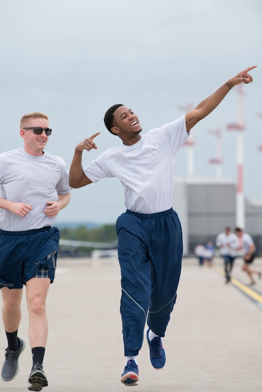 Airman Male points to sky