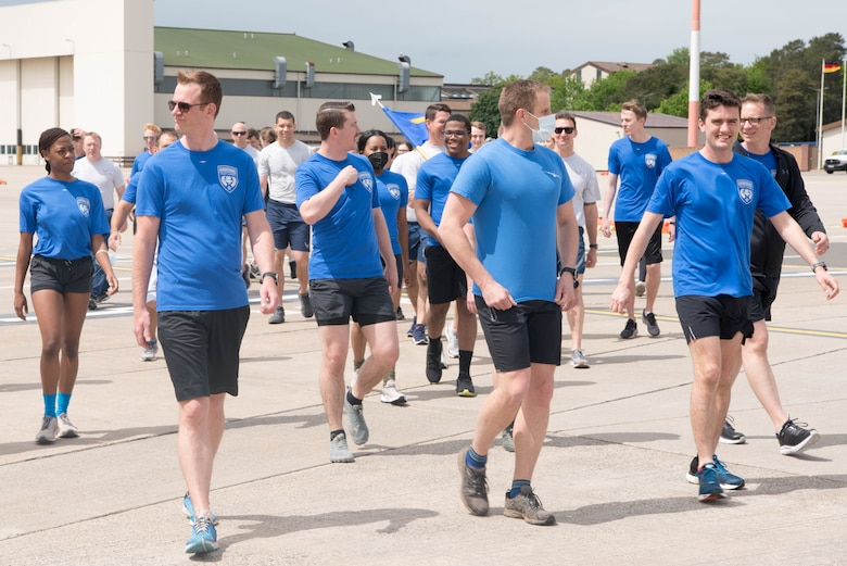 Airmen walk to flight line