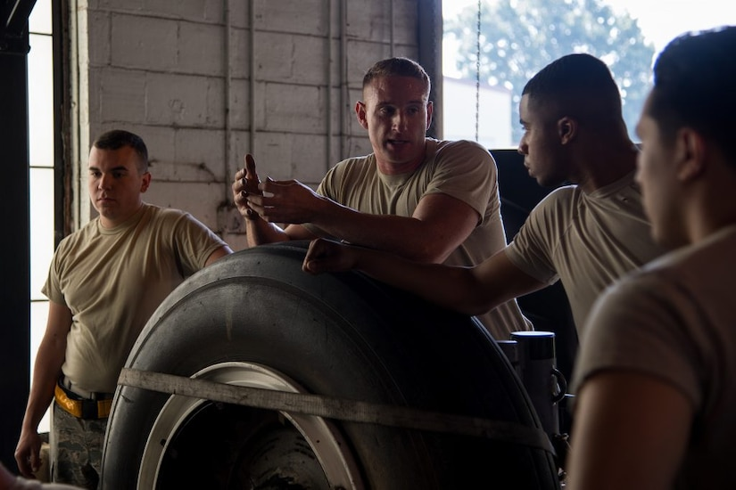 Tech. Sgt. Dylan Drake (middle), 372nd Training Squadron Field Training Detachment 5 crew chief instructor, speaks to his students during a crew chief course at Barksdale Air Force Base, Louisiana, June 4, 2019. The only two FTDs to train B-52H Stratofortress maintainers are located at Barksdale and Minot Air Force Base, S.D. (U.S. Air Force photo by Senior Airman Tessa B. Corrick)