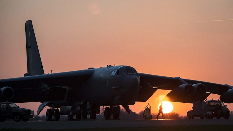 A crew chief deployed from the 2nd Aircraft Maintenance Squadron, 20th Aircraft Maintenance Unit, Barksdale Air Force Base, La., starts his work on a B-52 Stratofortress that landed minutes before at RAF Fairford, England, March 28, 2019. The 20th AMU is attached to the 20th Bomb Squadron's B-52s, and the unit maintains those B-52s anywhere they deploy. (U.S. Air Force photo by Staff Sgt. Philip Bryant)