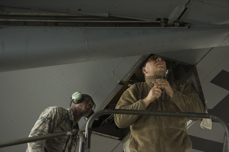 Staff Sgt. Jonathan Dantuma and Airman 1st Class Raeqwon Brown, aircraft electrical and environmental maintainers with the 60th Aircraft Maintenance Squadron, work on the flightline at Travis Air Force Base, California, servicing C-5M Super Galaxy aircraft, Mar. 22, 2019. (U.S. Air Force photo by J.M. Eddins Jr.)