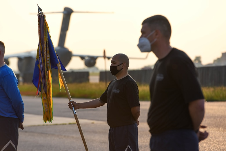 Airmen assigned to the 724th Aircraft Maintenance Squadron stand in formation before a Port Dawg' memorial run at Aviano Air Base, Italy, May 27, 2021. The memorial run is held annually throughout the career field as a way to honor members that have fallen while serving as a 'Port Dawg.' The event is an opportunity to highlight the importance of the Port Dawgs in the AMS installations and community. (U.S. Air Force photo by Airman 1st Class Brooke Moeder)
